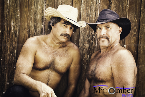 Stock Image - Couple of hairy gay mature cowboys