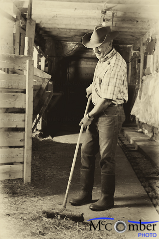 Stock Photo - Farmer cleaning up his barn vintage