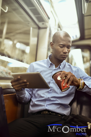 Stock Image: Black businessman checking time in subway