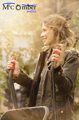 Stock Image: Adult woman having fun Autumn gardening