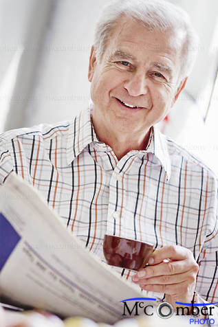 Stock Image: Senior man morning portrait with newspaper and espresso