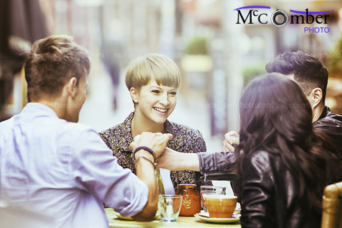 Stock Image: Four  young friends having fun at a Berlin Café