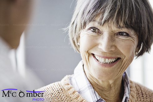 Stock Image: Close-up of a senior woman in conversation, smiling