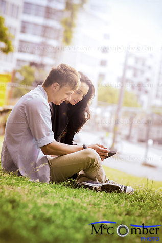Stock Image: Young couple in love using tablet in a park