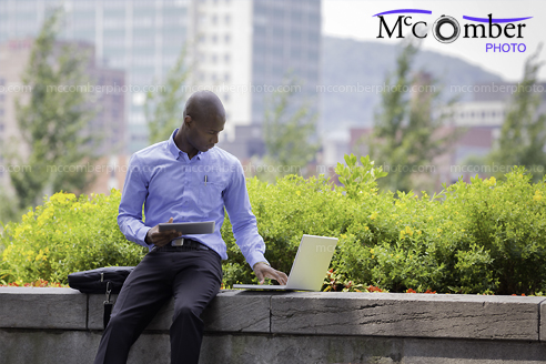 Stock Image: Business man working outside in Montreal