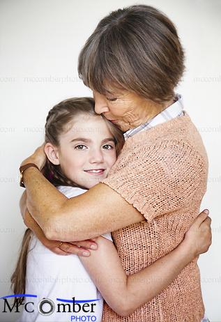 Stock Image: Grandmother hugging her granddaughter