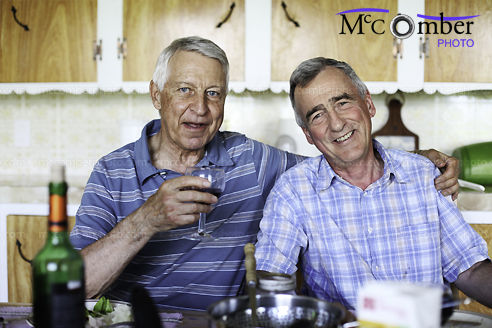 Stock Image: Couple of smiling male seniors at meal time